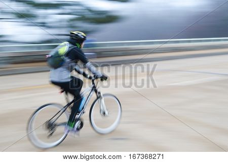 A bicycle rider in motion blur