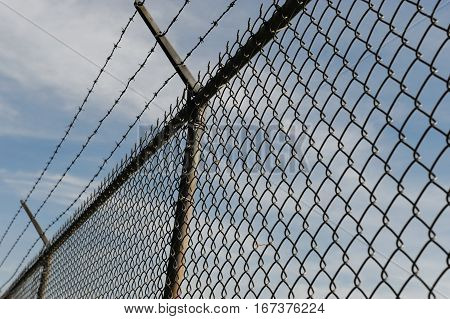 iron chain link fence and blue sky