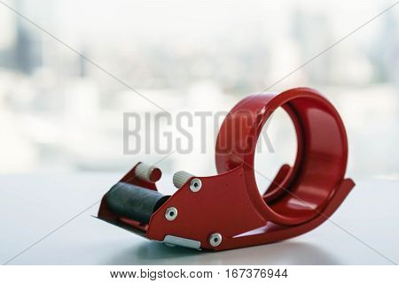 close up isolated red adhesive tape dispenser