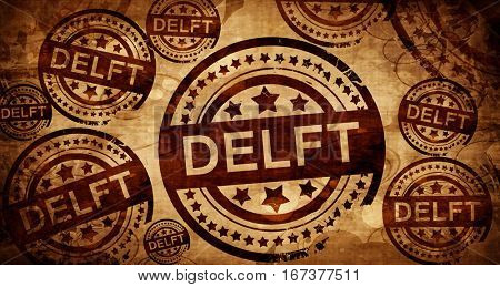 Delft, vintage stamp on paper background