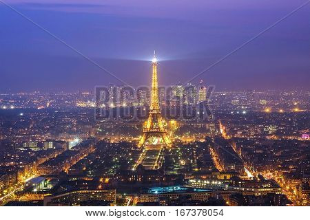 PARIS - MARCH 15, 2015 : The beautiful Eiffel Tower brightly illuminated at night on MARCH 15, 2015 in Paris. The Eiffel tower is the most famous landmark and  most visited monument in Paris, France.