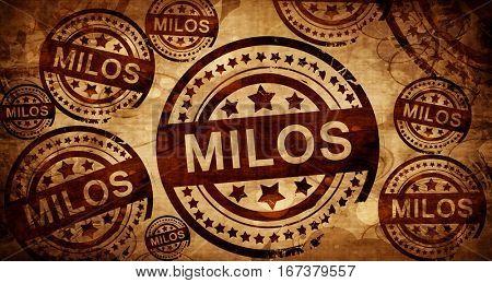 Milos, vintage stamp on paper background