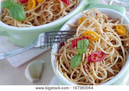 tasty spaghetti aglio e olio e peperoncini with parmesan