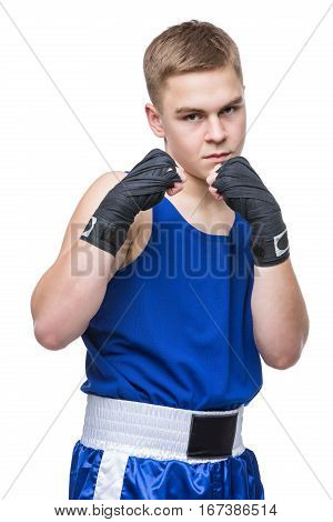 Young handsome boxer sportsman in blue boxer suit and black wrist wraps standing on white backgound. Isolated. Copy space.