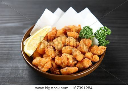 studio shot of fried chicken cartilage with lemon