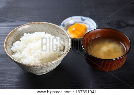 rice and miso soup on a table