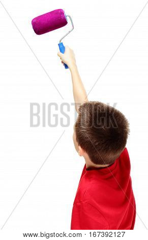 Back view of boy painting something with roller on white background