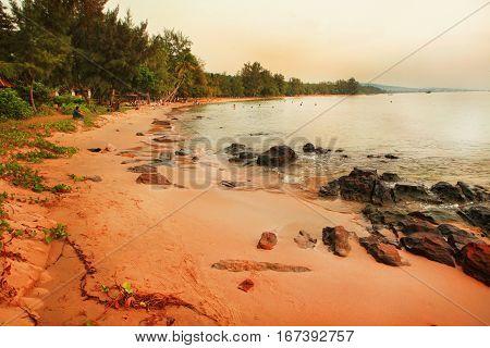 stony beach horizontal photo on sunset sky background