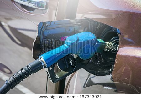 Close-up fuel nozzle. Fill up fuel at gas station