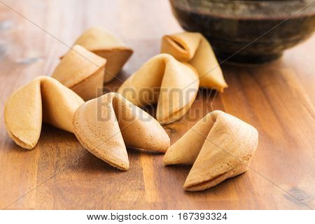The fortune cookies on wooden table.