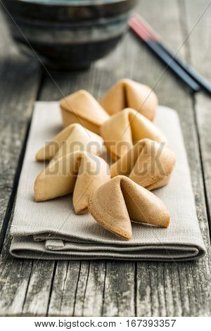 The fortune cookies on napkin.