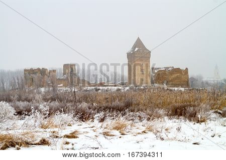 Ruins of medieva Bac fortress in Serbia on foggy winter day