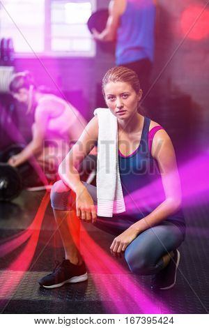 Portrait of serious woman crouching in gym