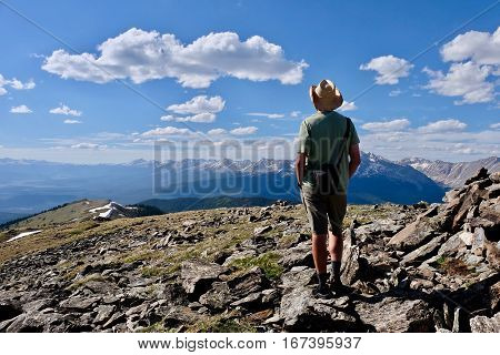Man hiker at mountains. Alpine tundra at Independence Pass. Denver. Aspen. Colorado. United States.