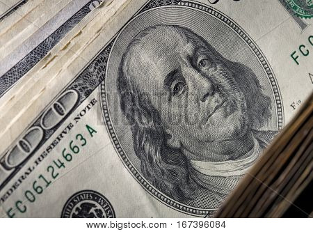 Hundred dollar denomination close up. Money background.