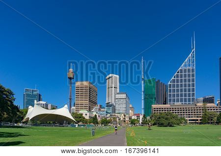 Sydney Domain, Public Space With Cbd Skyline On The Background