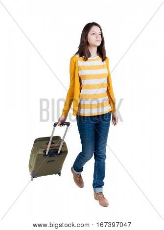 front view of walking  woman  with suitcase. beautiful brunette girl in motion. backside view of person.  Rear view people collection. Isolated over white background. girl takes big suitcase on wheels