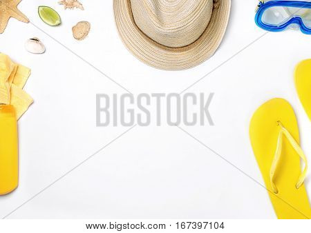 Different beach items on white background vacation and travel items top view