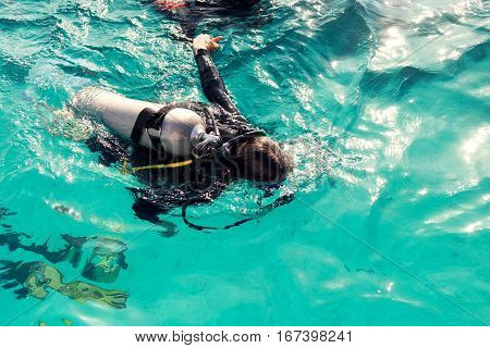 Couple divers plunged into the ocean top view with copy space