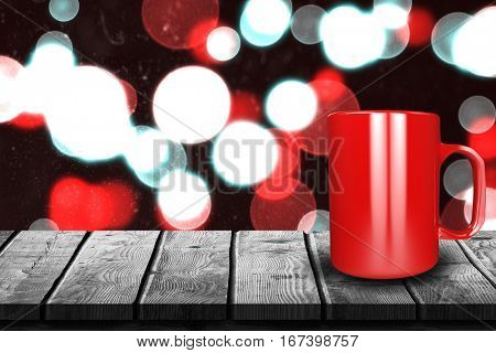 Close up of red mug against digitally generated twinkling light design 3d