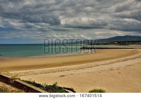 Ocean coast in the north west of Spain, Galicia region, little town of Foz, urban beach detail