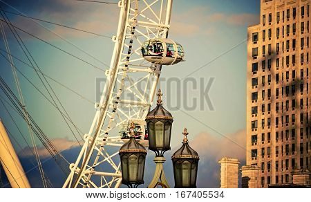 London UK - February 23 2016: London Eye or Millennium Wheel at Jubilee Gardens on the South Bank of the River Thames.