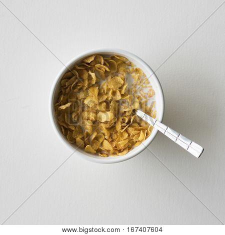 Cornflakes Bowl Spoon On A White Table