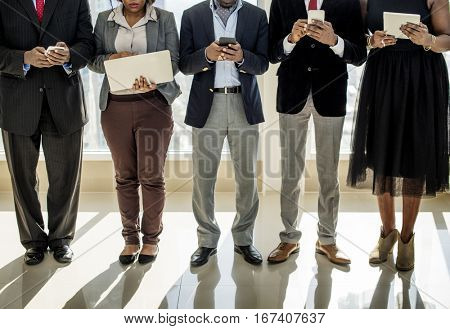 Diverse Business People Use Digital Devices