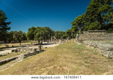 Ancient Olympia, Greece - SEPTEMBER 2016: Tourists in the Sanctuary of ancient Greece