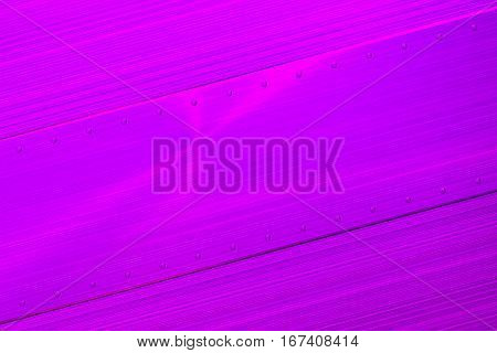 Rectangular Brushed Metal Plate With Rivets On Brushed Metal Background