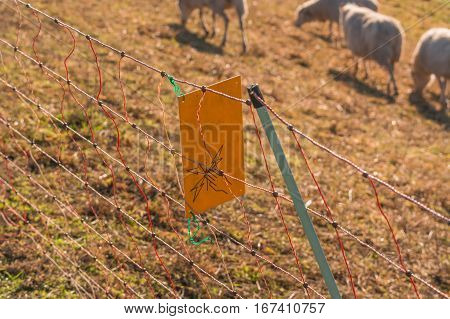 Yellow warning sign Caution Electric wicker fence