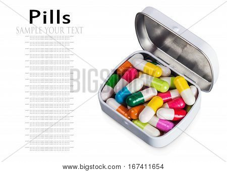 many different colored pills isolated on white background. delete the text
