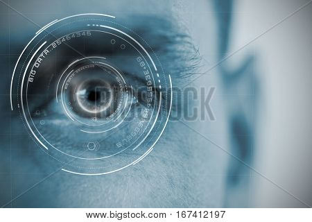 Digital image of globe with big data text against close up human eye