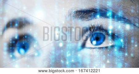 Digitally generated black and blue matrix against close up of woman with brown eyes
