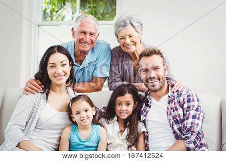 Portrait of happy multi generation family at home