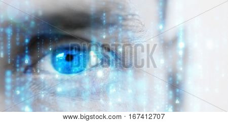 Digitally generated black and blue matrix against close up human eye