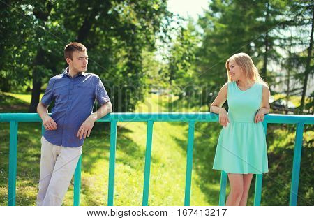 Couple Looking At Each Other On The Distance - Love, Relationships, Dating And Flirting Concept