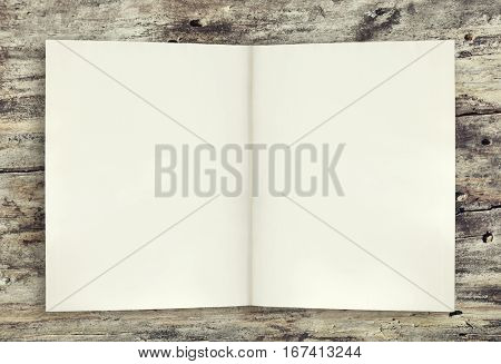 Empty background page of book on the wooden table