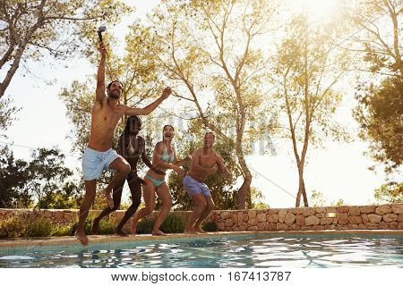 Friends On Vacation Taking Selfie Of Jumping Into Pool