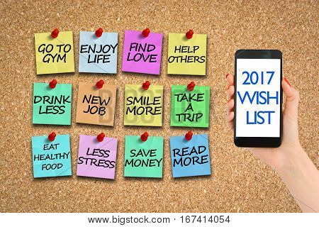 New year's resolution/ 2017 wish list on corkboard with colorful paper pins