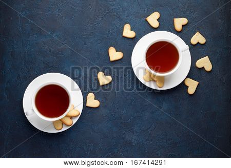 Romantic Tea Party For Lovers On Valentines Day. Sweet Heart Shaped Cookies With Two Cups Of Tea On