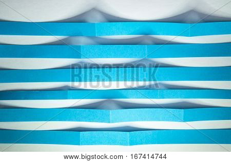 abstract background blue paper strips as ripples