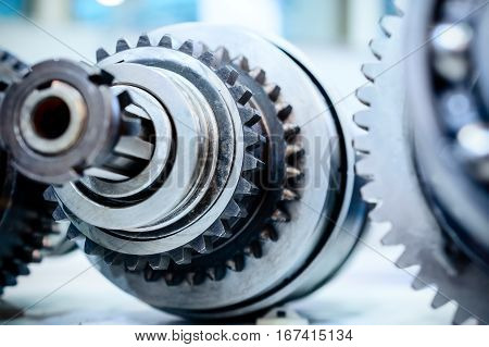 Metal shaft with gears and spline teeth. Friction clutch machine tool.