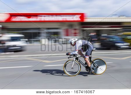 Conflans-Sainte-HonorineFrance-March 62016: Panning image of the Swiss cyclist Gregory Rast of Trek-Segafredo Team riding during the prologue stage of Paris-Nice 2016.