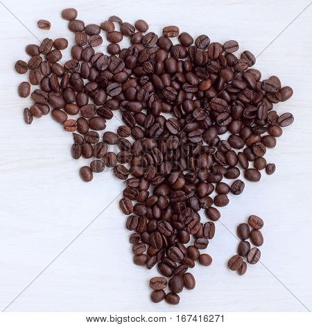 coffee beans collected on the table in the shape maps continent a top view / Afrikaans origin present