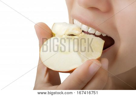 close-up of beautiful teeth a girl biting an apple isolated on white background