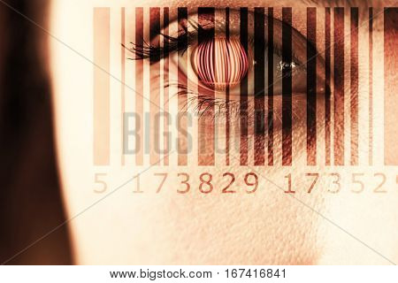 Composite image of Bar code against close up of gray eye
