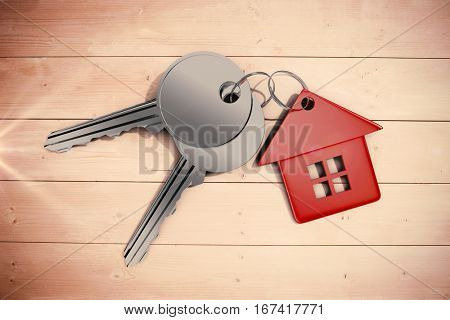Keys with red home ring against overhead of wooden planks