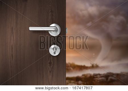 Brown door with key against mountain during tornado disaster