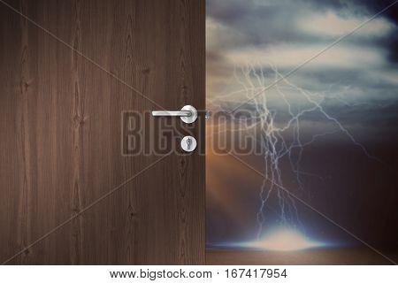 Brown door against thunderstorm over landscape